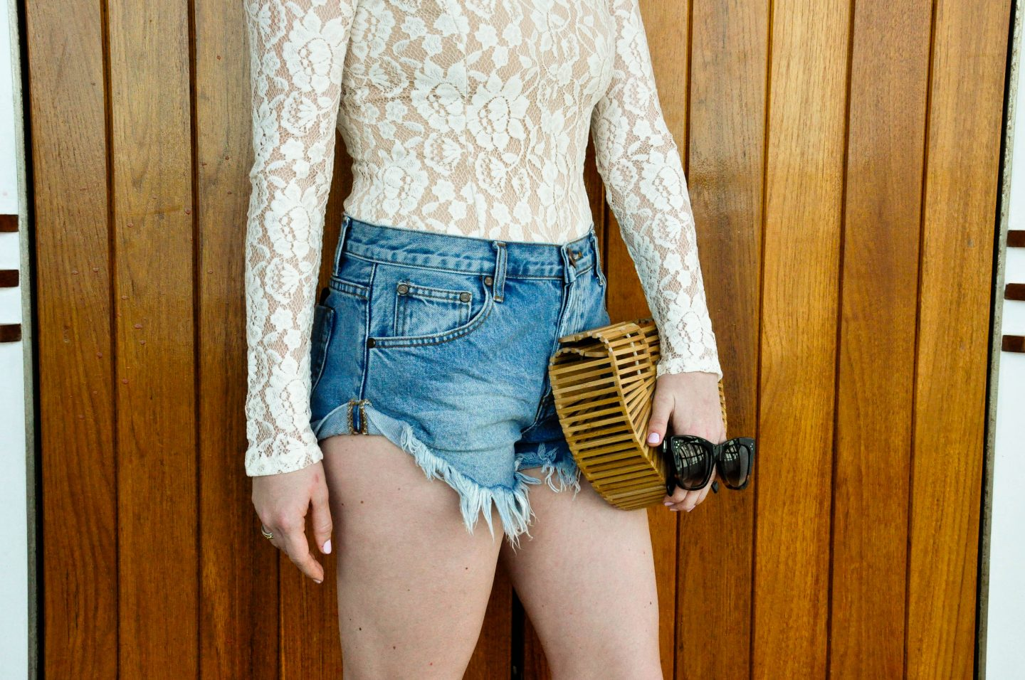 Lifestyle blogger Mollie Sheperdson wearing an Ella Moss lace bodysuit and One Teaspoon shorts