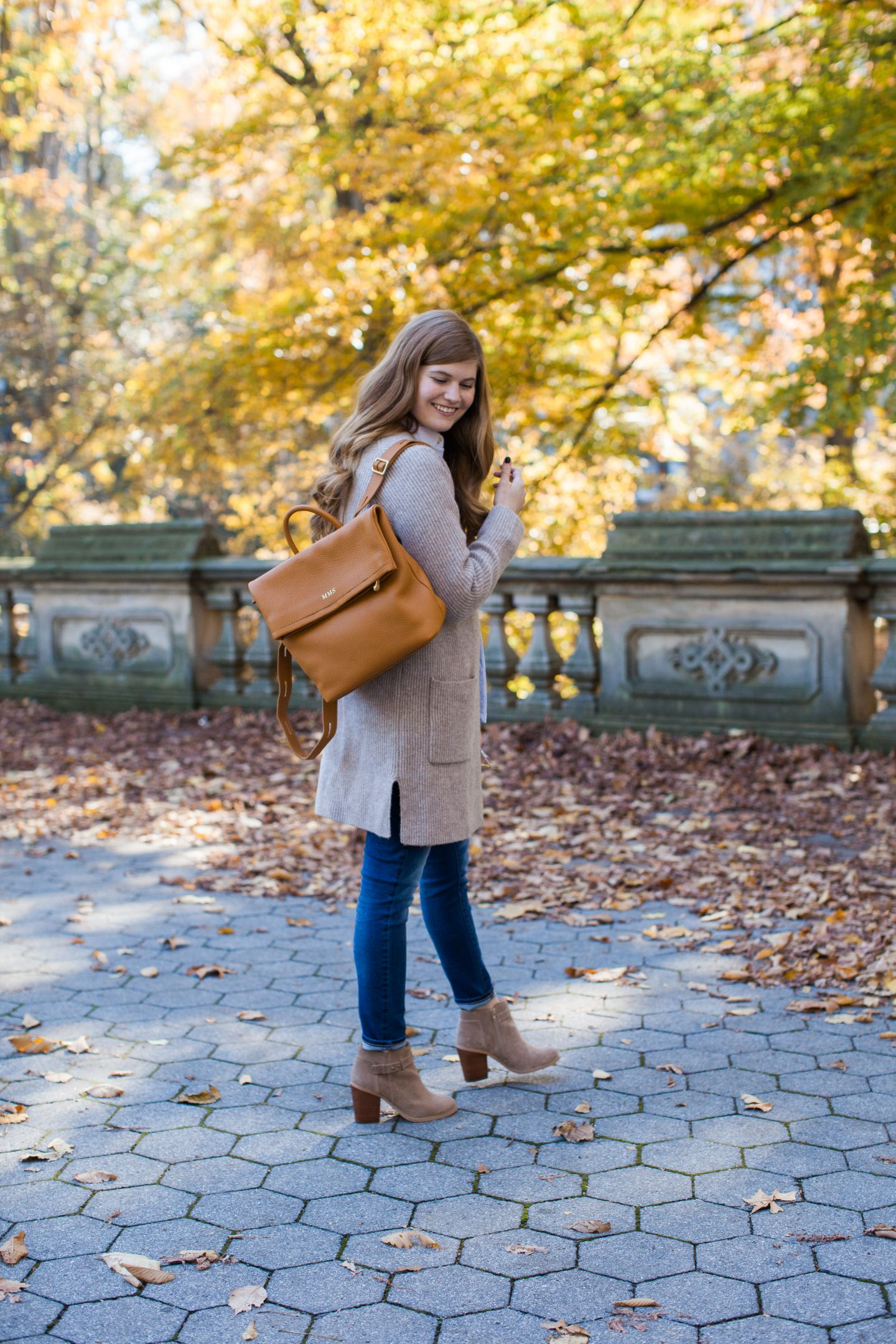Lifestyle blogger Mollie Sheperdson wearing a Madewell sweater and GiGi New York backpack