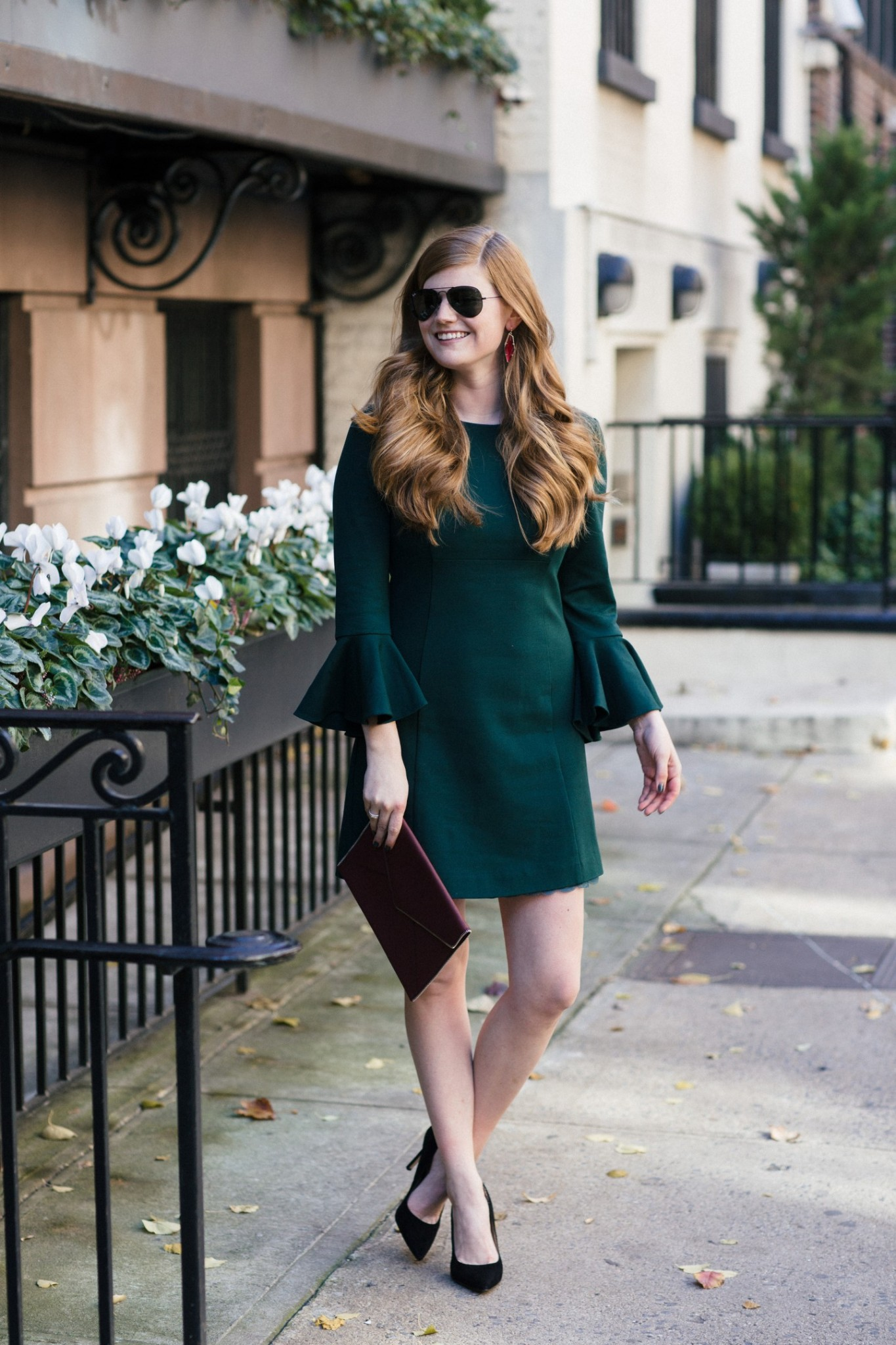 Lifestyle blogger Mollie Sheperdson shares a holiday party look with Rent the Runway