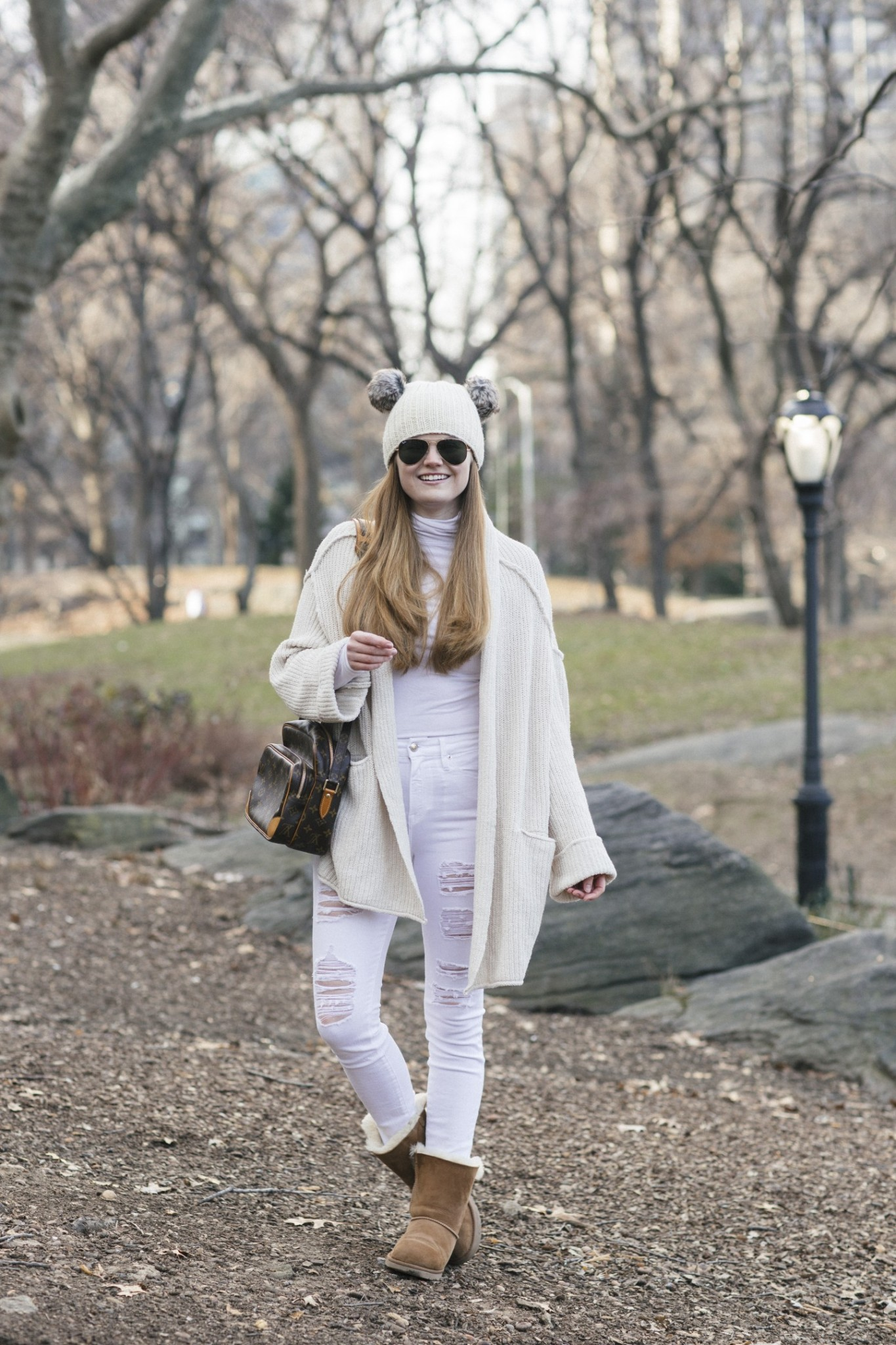 Lifestyle blogger Mollie Sheperdson shares a Winter White look in the Free People Low Tide Cardigan