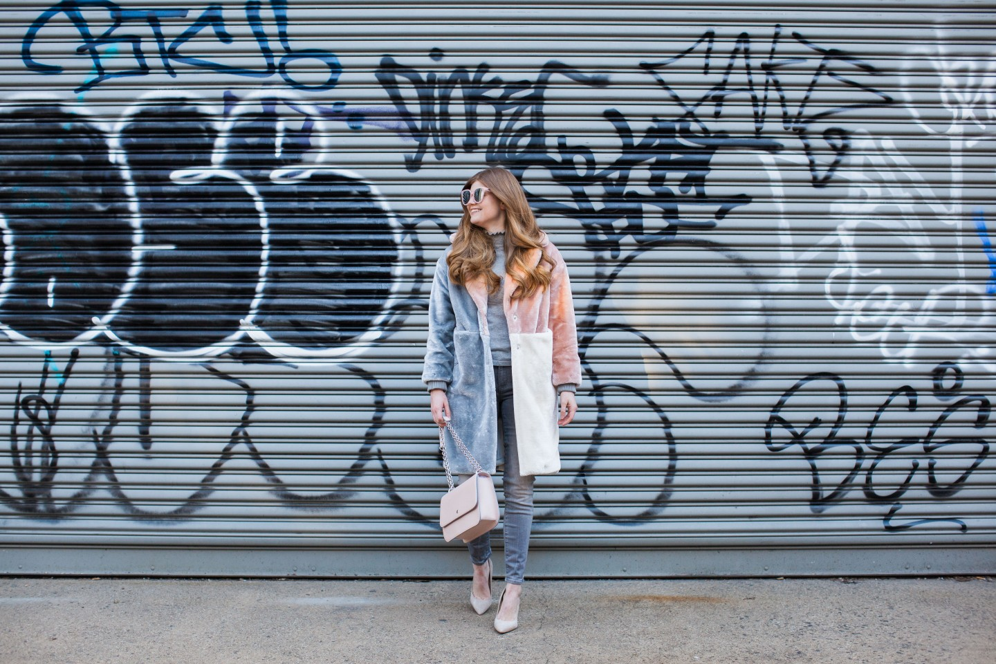 Lifestyle blogger Mollie Sheperdson a faux fur coat she wore to NYFW