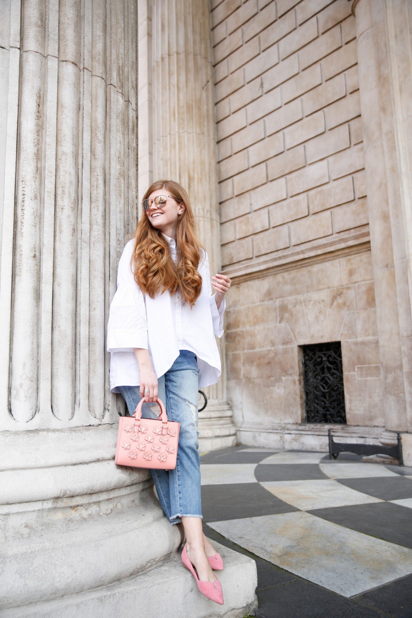 Lifestyle blogger Mollie Sheperdson wears a Rent the Runway blouse in London